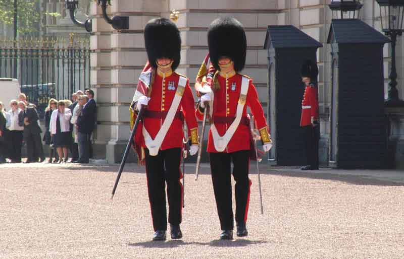 Two marching soldiers at Buckingham Palace.